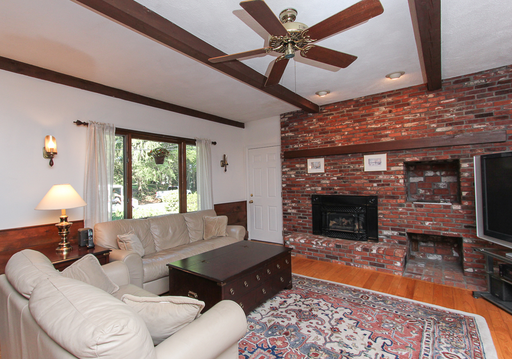 Family room with fireplace at 28 Juniper Street in Wenham, MA