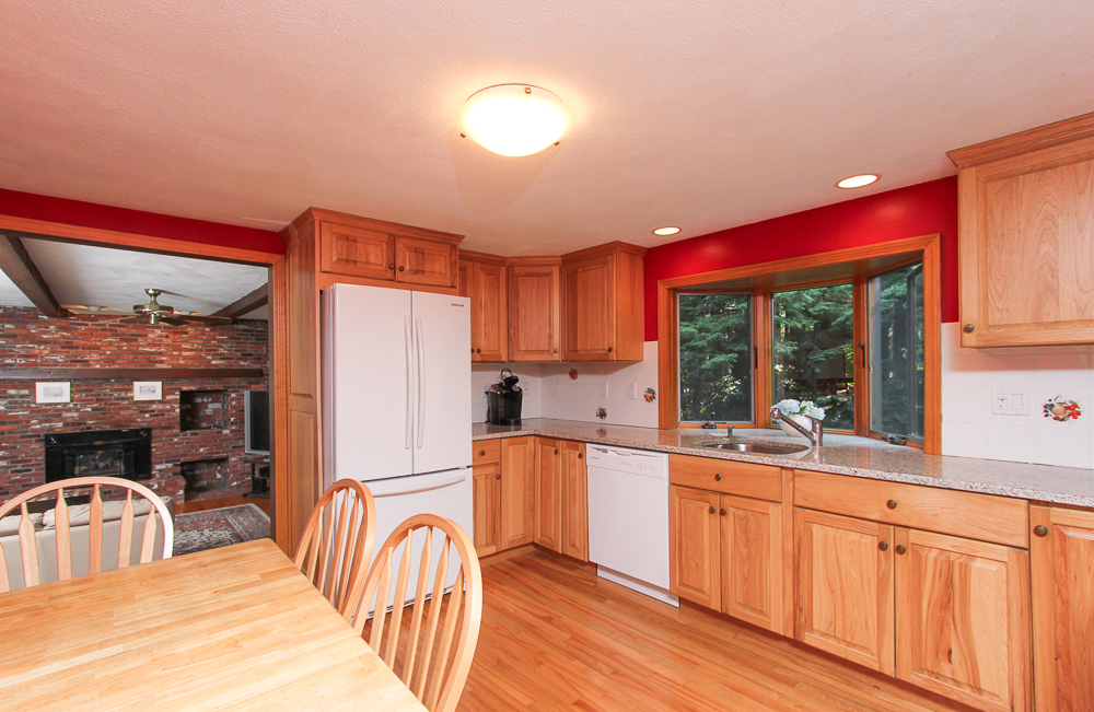 Kitchen view into family room at 28 Juniper Street in Wenham