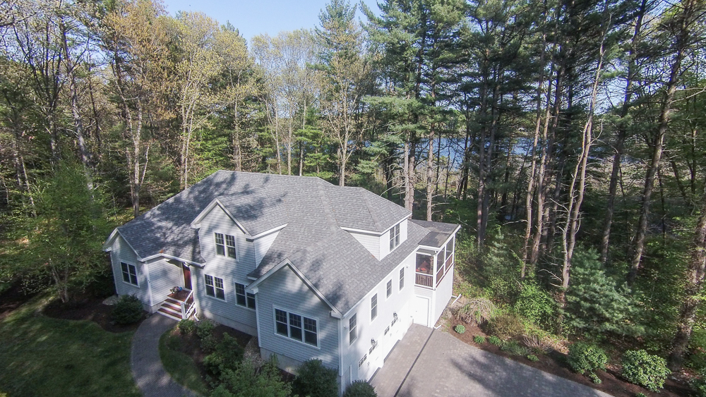 Aerial front of the house and pond - 40 Beaver Pond Road Beverly, MA