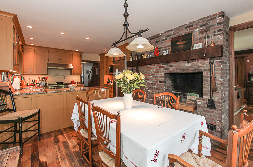 Dining room with brick fireplace and kitchen 4 Lanes Road Essex Massachusetts