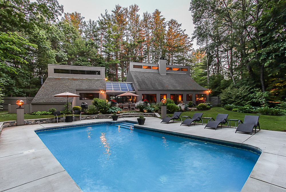 Twilight pool and house 27 Miles River Road Hamilton Massachusetts