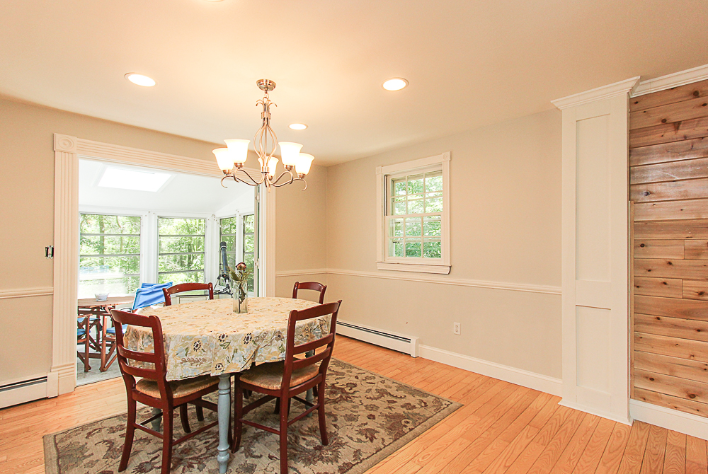 Dining room with doors that open to the porch 84 Old Cart Road Hamilton Massachusetts