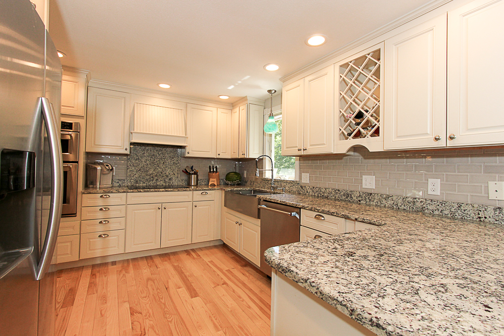 Kitchen with granite counters and hardwood floors 84 Old Cart Road Hamilton Massachusetts