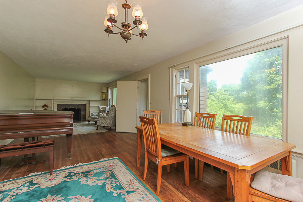 Dining room and living room beyond at 31 Decatur Street Gloucester Massachusetts