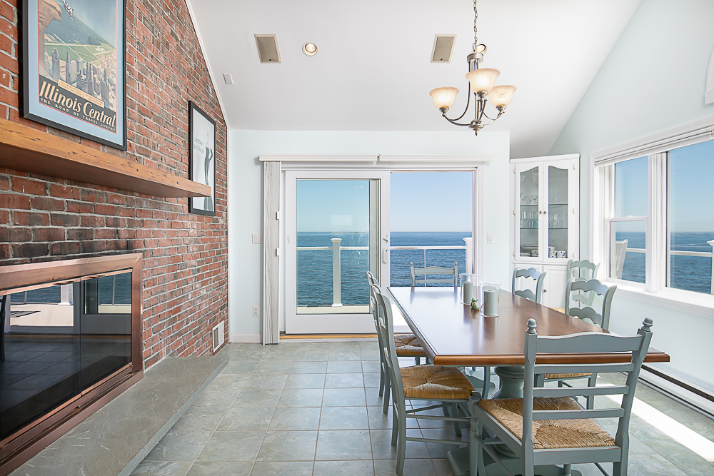 Dining room with fireplace and tile floors 20 High Rock Terrace Gloucester Massachusetts