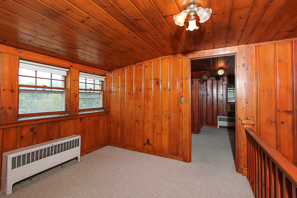 Hallway with wood paneling at 31 Decatur Street Gloucester Massachusetts