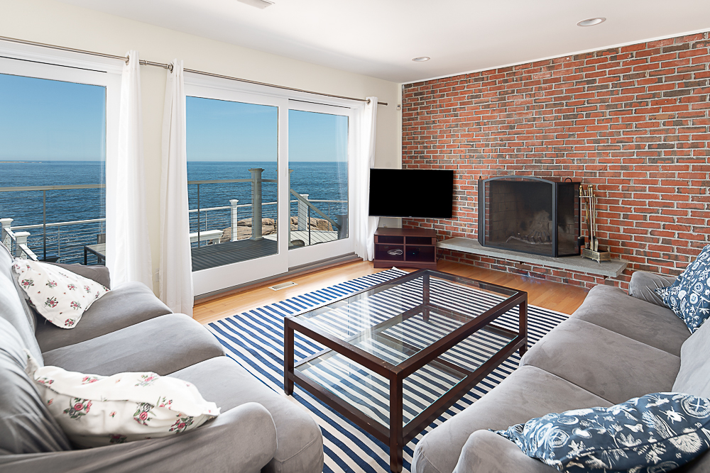 Lower level living room with brick fireplace and sliders to deck 20 High Rock Terrace Gloucester Massachusetts