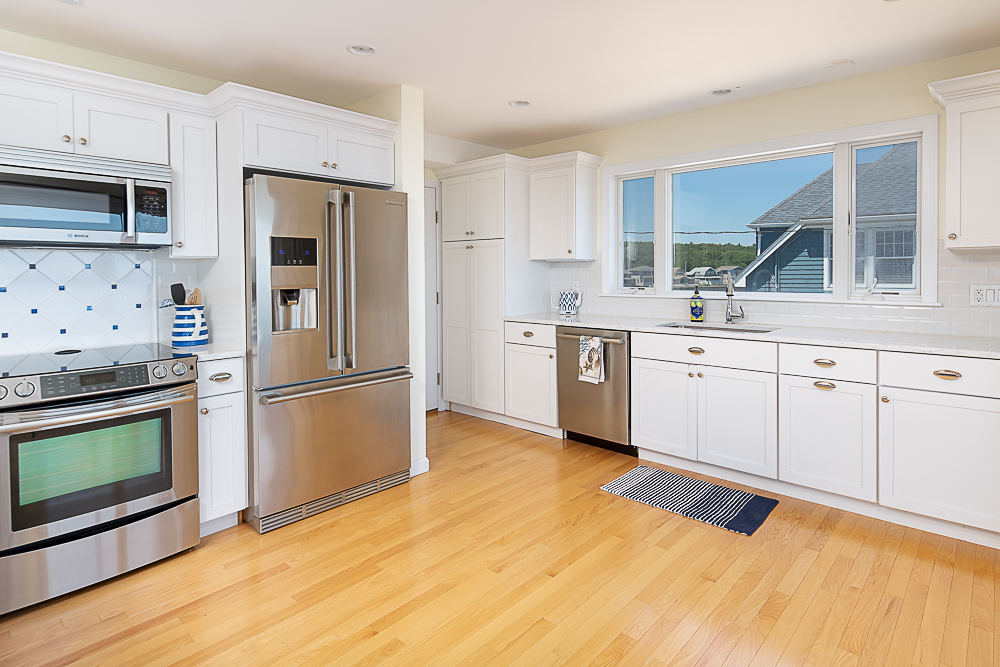 Lower level kitchen with white cabinets and stainless appliances 20 High Rock Terrace Gloucester Massachusetts