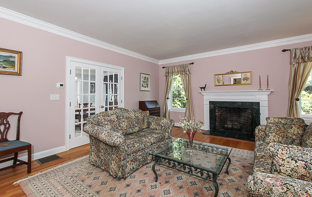 Living room with fireplace and French doors 54 Essex Street Hamilton Massachusetts