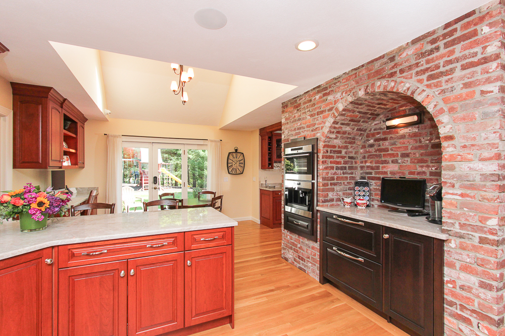 Kitchen with skylight, brick wall with recessed counter and double ovens at 48 Boren Lane Boxford Massachusetts
