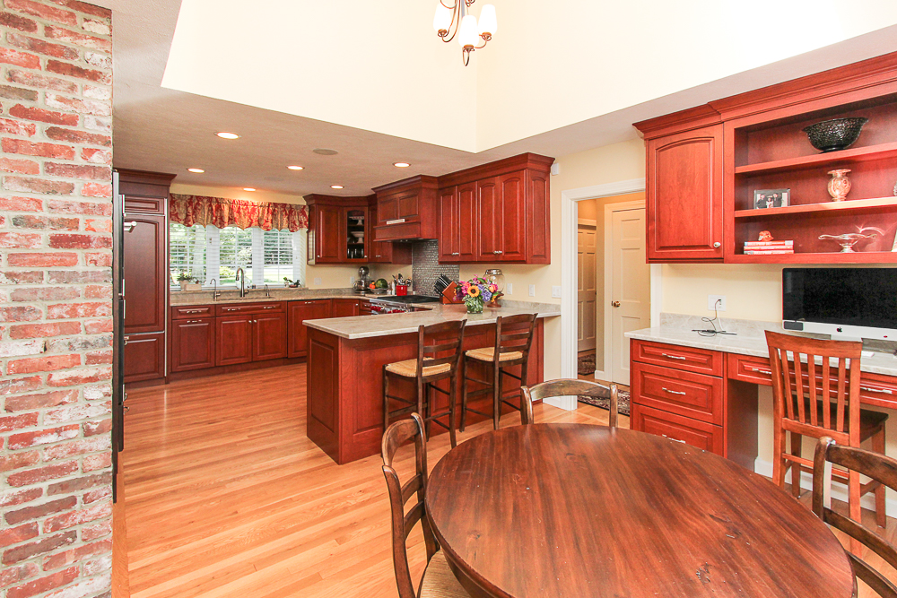 Cherry cabinets and dining area at 48 Boren Lane Boxford Massachusetts