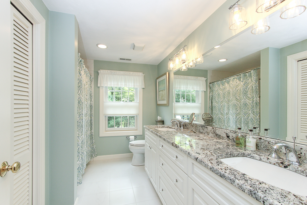 Bathroom with tile floors, double sinks and granite counters at 48 Boren Lane Boxford Massachusetts