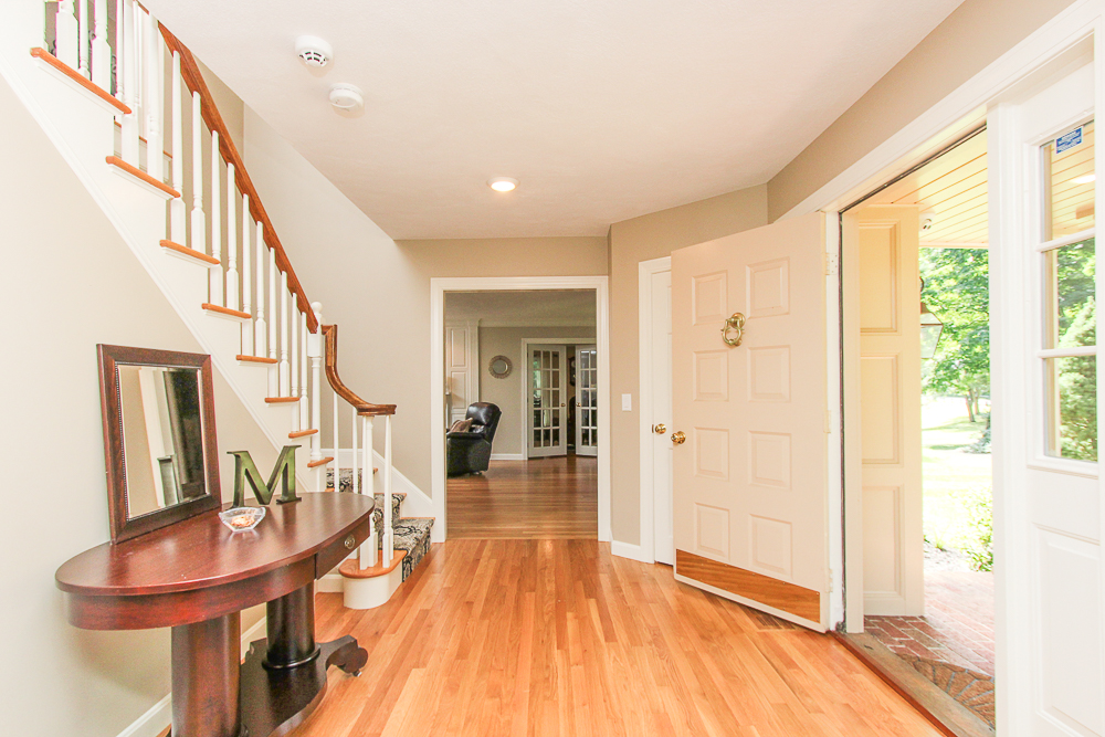 Foyer with open front door hardwoof floors and stairs to the second floor at 48 Boren Lane Boxford Massachusetts