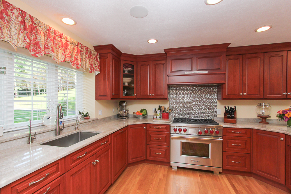 Kitchen with cherry wood cabinets Stainless steel stove and hardwood floors 48 Boren Lane Boxford Massachusetts
