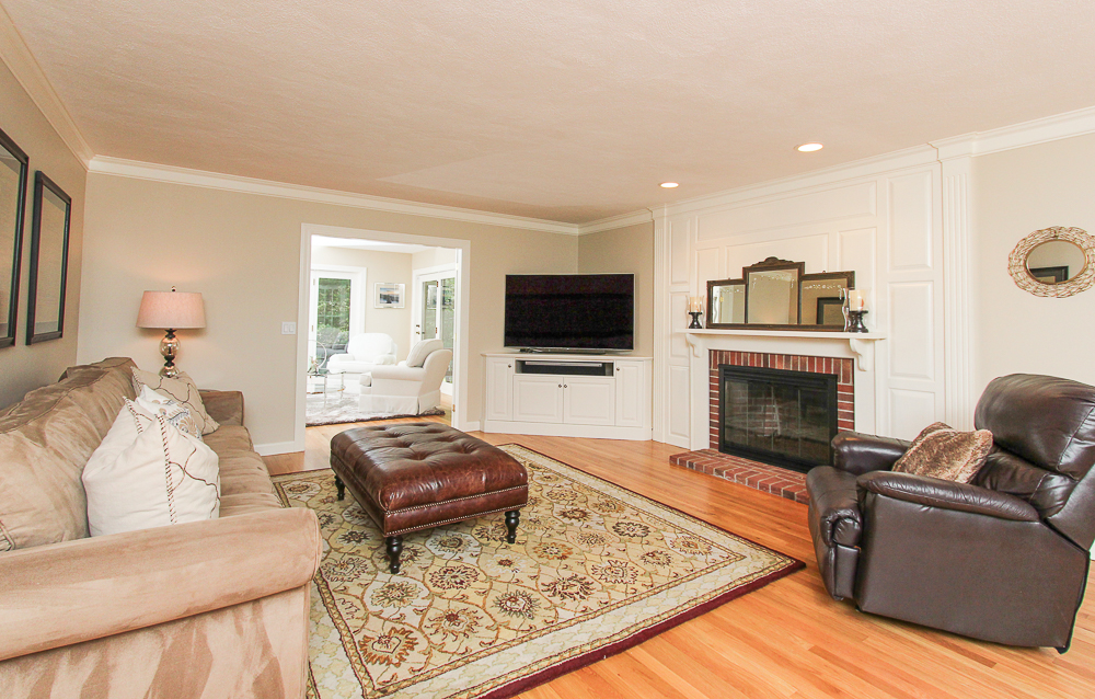 Living room with hardwood floors and fireplace 48 Boren Lane Boxford Massachusetts