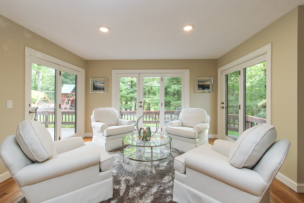 Sunroom with three sets of French doors to the deck 48 Boren Lane Boxford Massachusetts