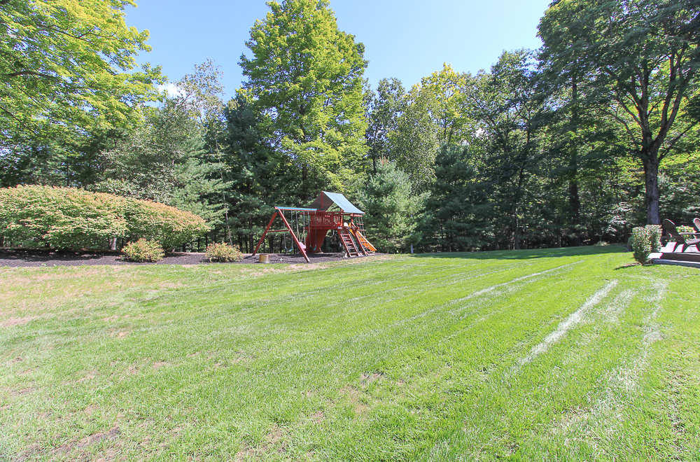 Yard with paly structure at 48 Boren Lane Boxford Massachusetts