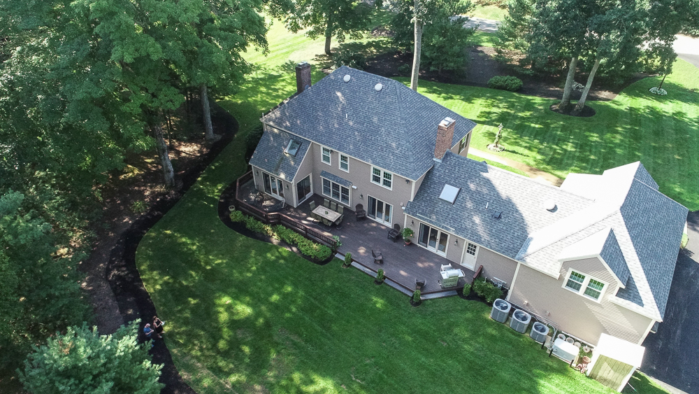 Aerial of the back, yard and deck of 48 Boren Lane Boxford Massachusetts