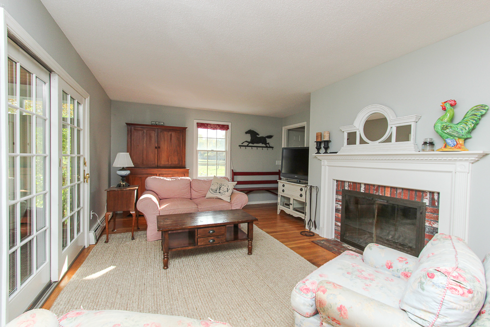 Family room with fireplace 245 Sagamore Street Hamilton Massachusetts