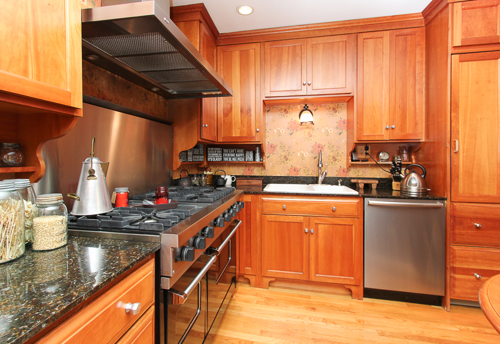 Kitchen with gas stove and cherry cabinets 26 Walnut Road Hamilton Massachusetts