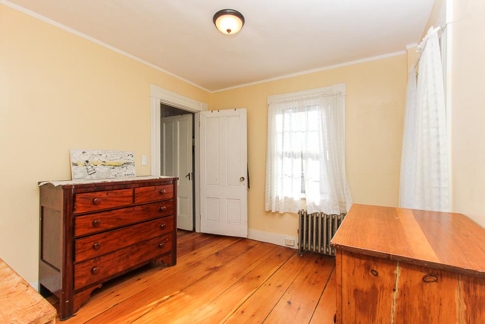 Nedroom with wide pine floors 160 Locust street Danvers Massachusetts