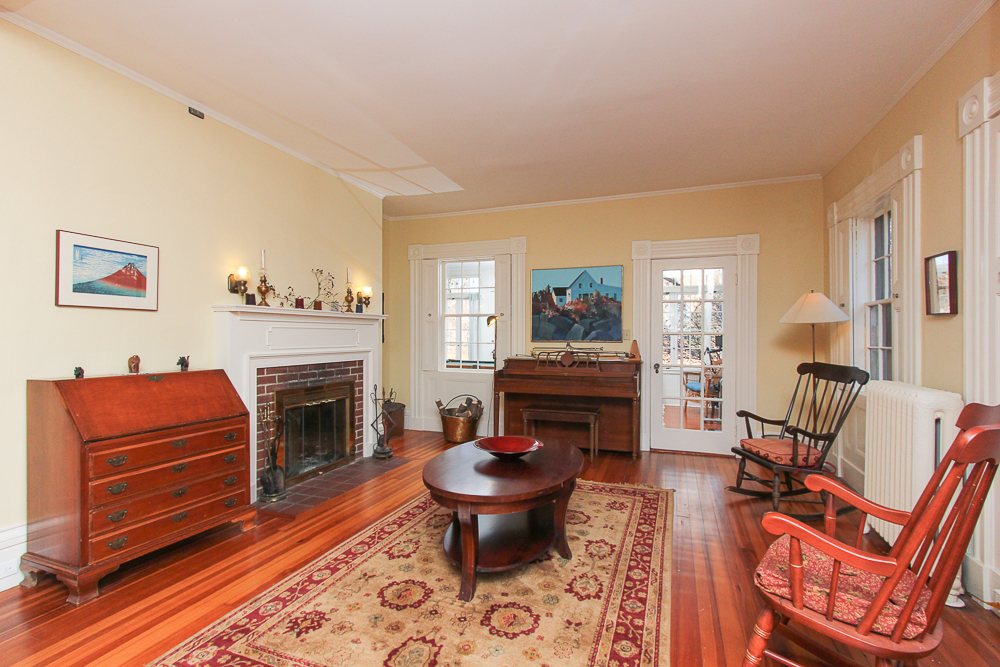 Family room with wood floors and fireplace 160 Locust street Danvers Massachusetts