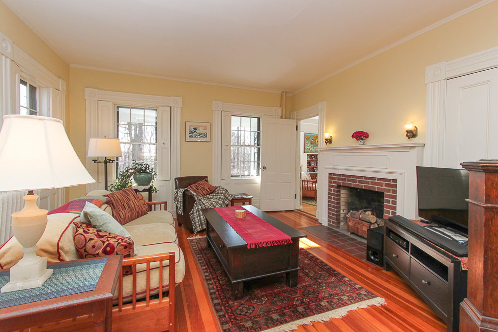 Living Room with Fireplace and wood floors 160 Locust street Danvers Massachusetts