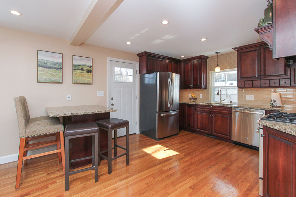 Kitchen ith cherry cabinets and granite counters 16 Alden Road Peabody Massachusetts