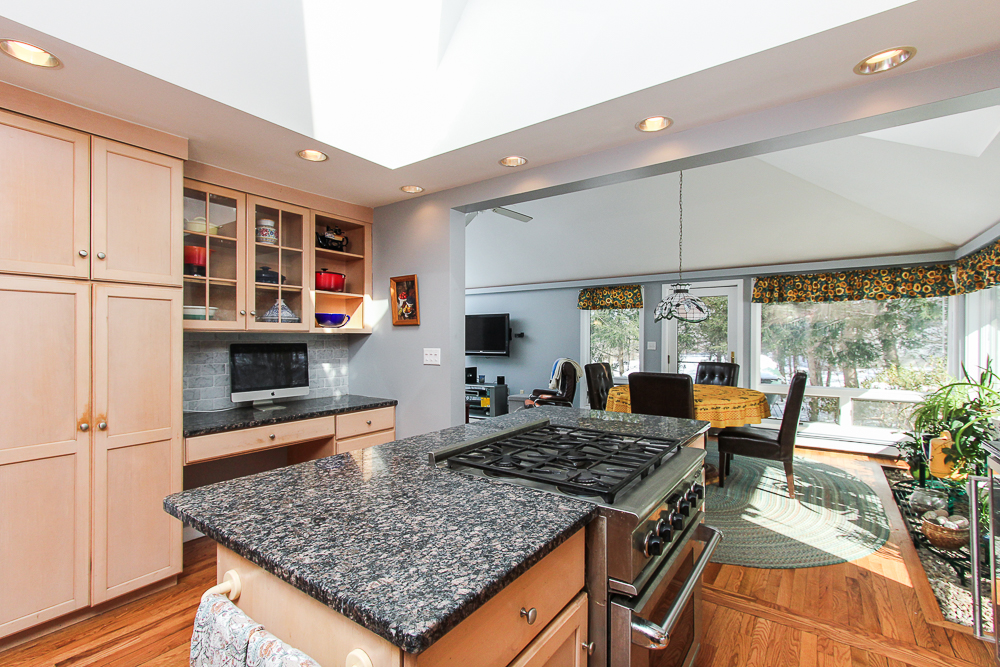 Kitchen island with granite open to the family room 140 Bridge Street Hamilton Massachusetts