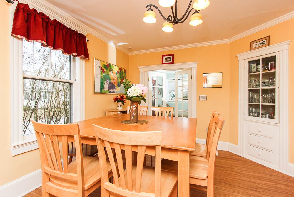 Kitchen dining area with built-in and hardwood floors 25 Porter Street Wenham Massachusetts