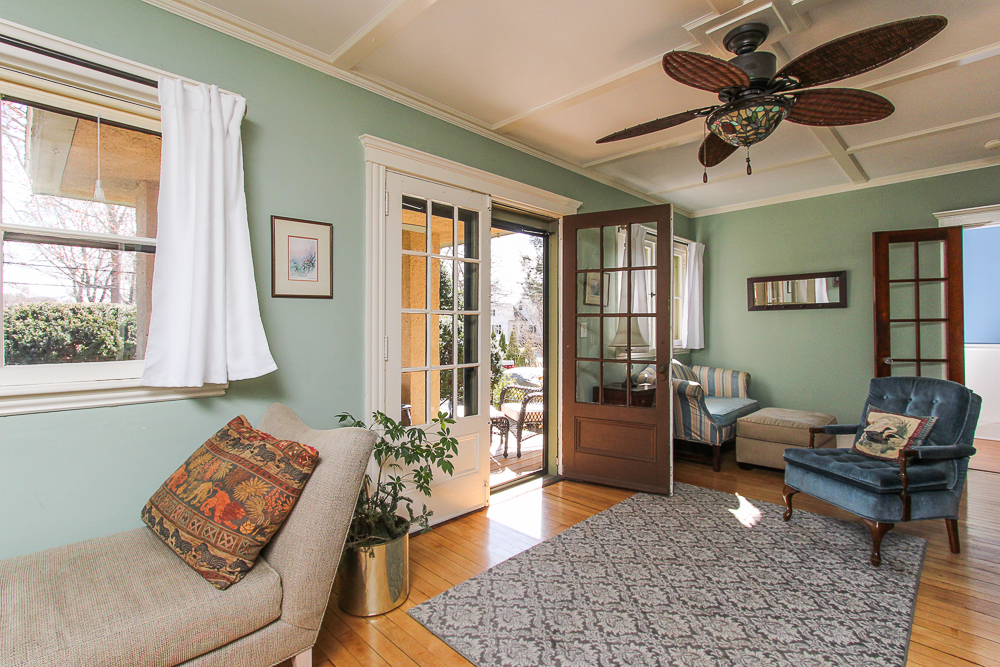 Living room with hardwood floors and ceiling fan double doors to the front porch 25 Porter Street Wenham Massachusetts