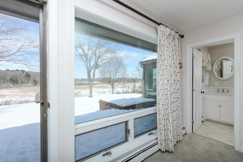 Main bedroom door to deck and private bathroom 140 Bridge Street Hamilton Massachusetts