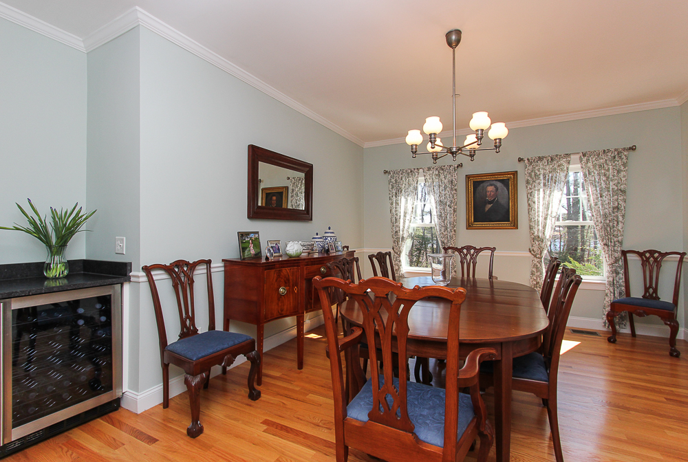 Dining roo with hardwood floors and wine refrigerator 41 Beaver Pond Beverly Massachusetts