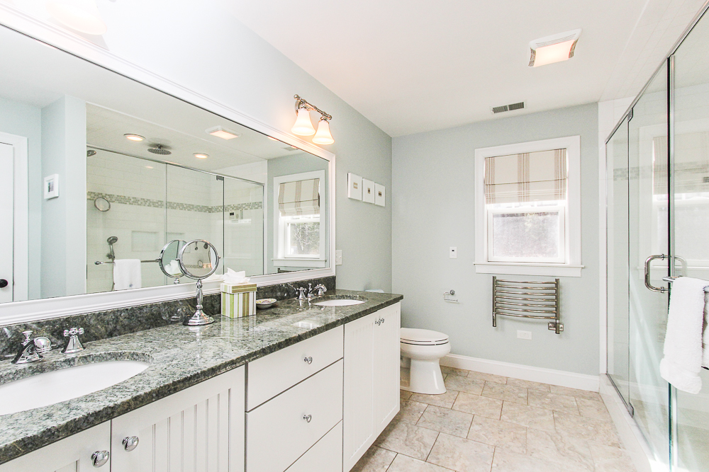 Master bathroom with glass shower and double sinks and granite counters 41 Beaver Pond Beverly Massachusetts