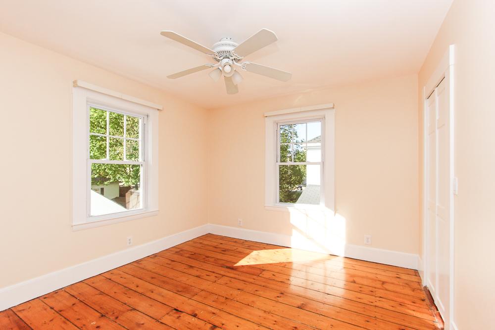 Bedroom with pine floors and ceiling fan 68 Union Street Hamilton Massachusetts