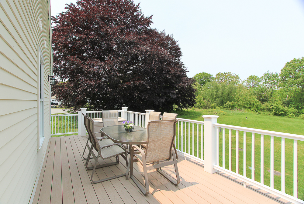 Dining table on deck looking at the Copper Beach Street 1 Patton Drive Hamilton Massachusetts