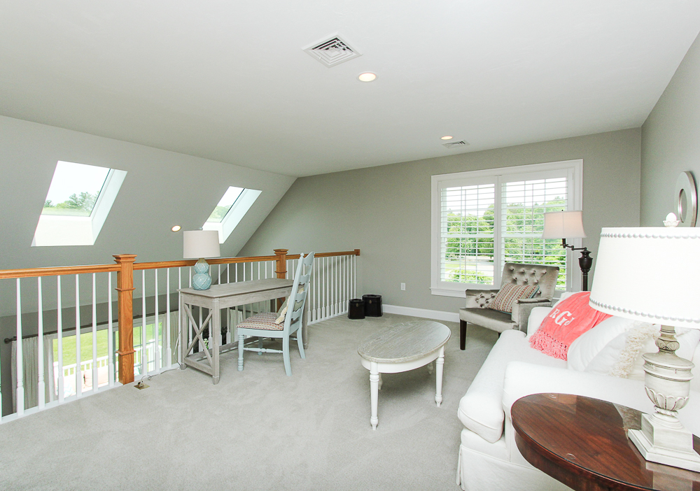 Loft with rail overlookig living room 1 Patton Drive Hamilton Massachusetts