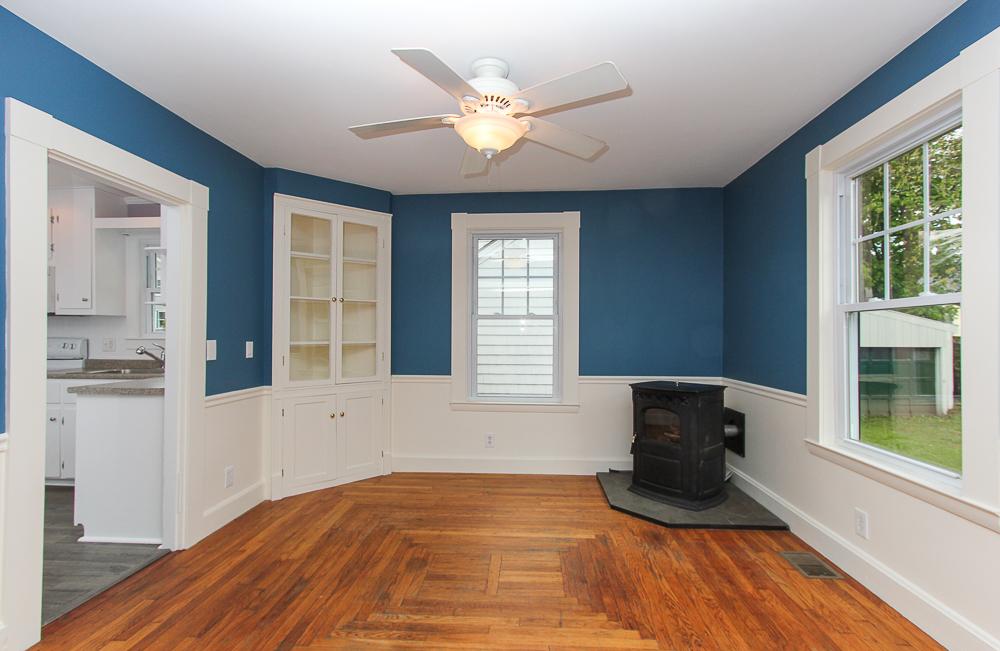Ding room with hardwood floors, built-in and pellet stove 68 Union Street Hamilton Massachusetts
