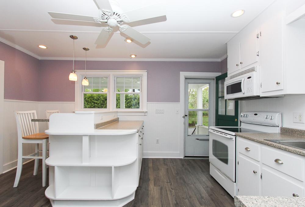 Kitchen with island and ceiling fan 68 Union Street Hamilton Massachusetts