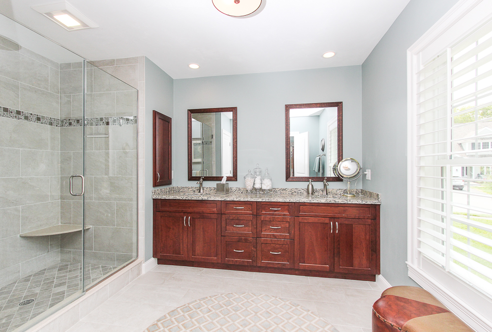 Master bathroom tiled double sinks and glass shower 1 Patton Drive Hamilton Massachusetts