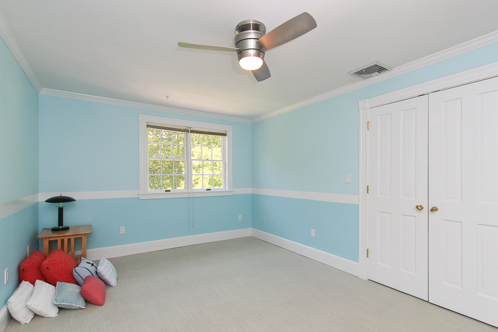 Bedroom with carpet and ceiling fan at 8 Gussett Road Wenham Massachusetts
