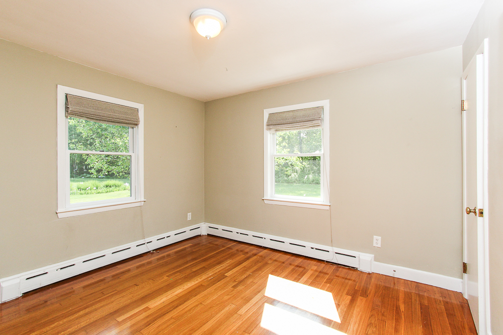 Bedroom with hardwood floors 101 Maple Street Wenham Massachusetts