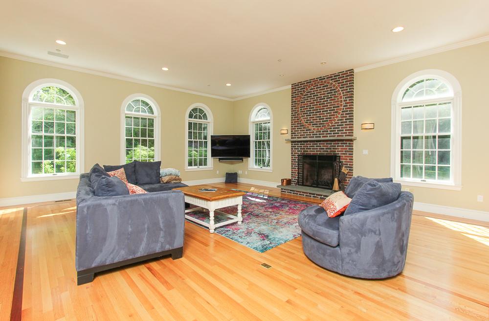 Family room with fireplace and hardwood floors 8 Gussett Road Wenham Massachusetts
