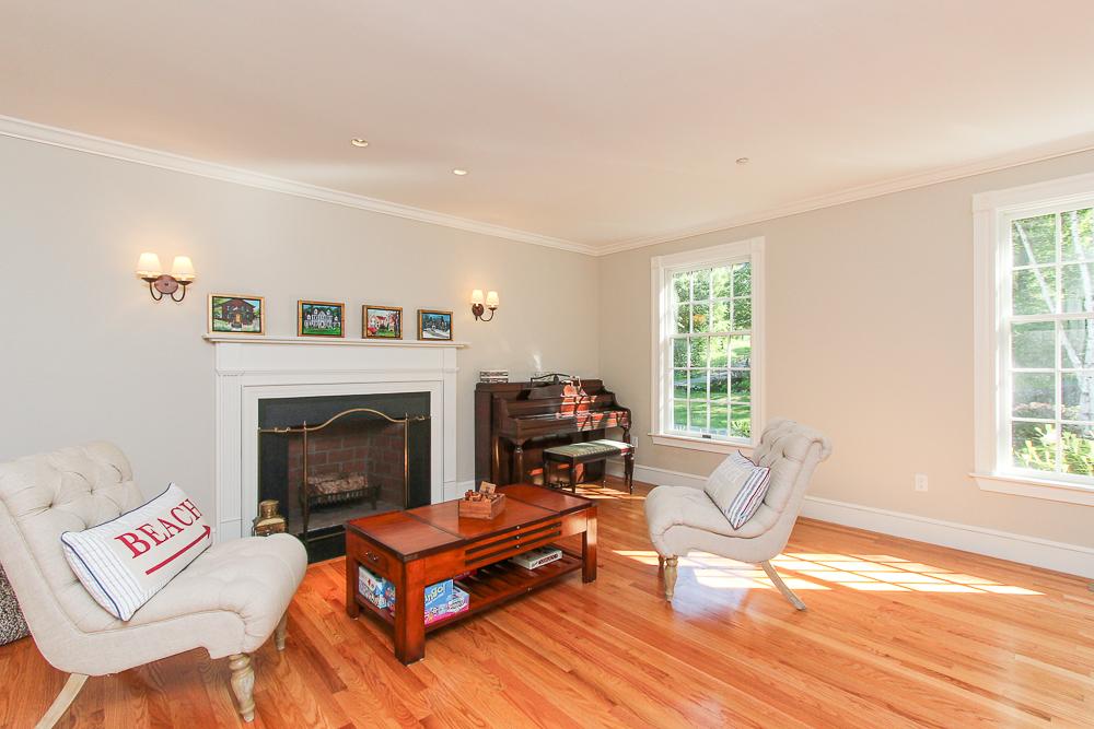 Living room with fireplace and hardwood floors 8 Gussett Road Wenham Massachusetts