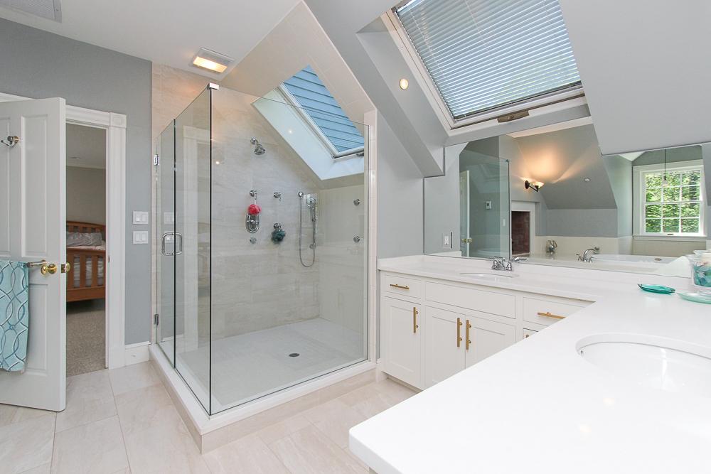 Main bathroom with glass shower and skylight 8 Gussett Road Wenham Massachusetts