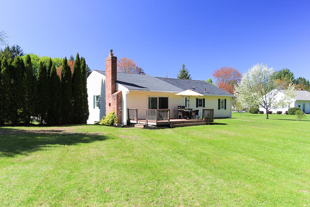 Rear with deck and yard 101 Maple Street Wenham Massachusetts