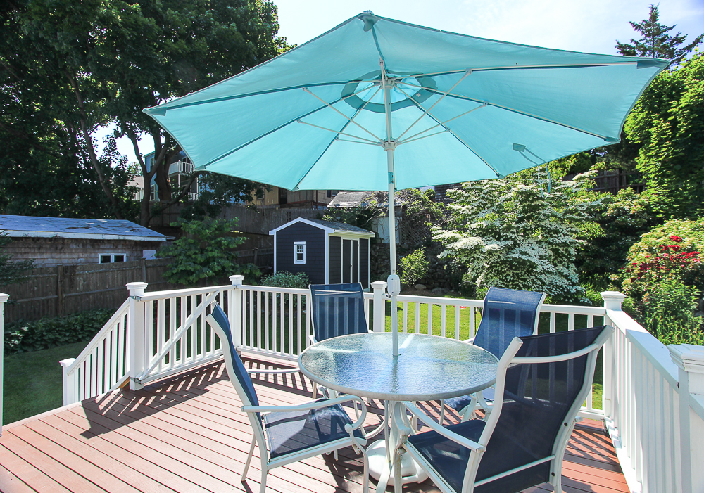 Dining table and umbrella on the deck 18 Hobart Avenue Beverly Massachusetts