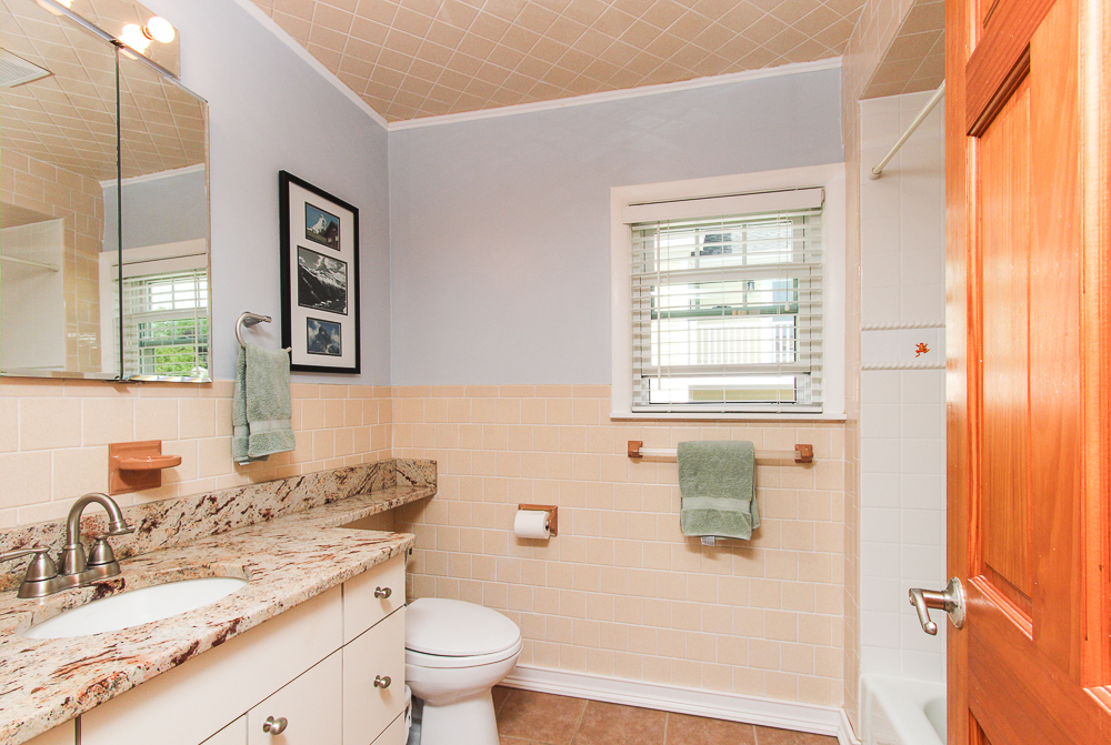 Shared bathroom with tle floors and granite counter 18 Hobart Avenue Beverly Massachusetts