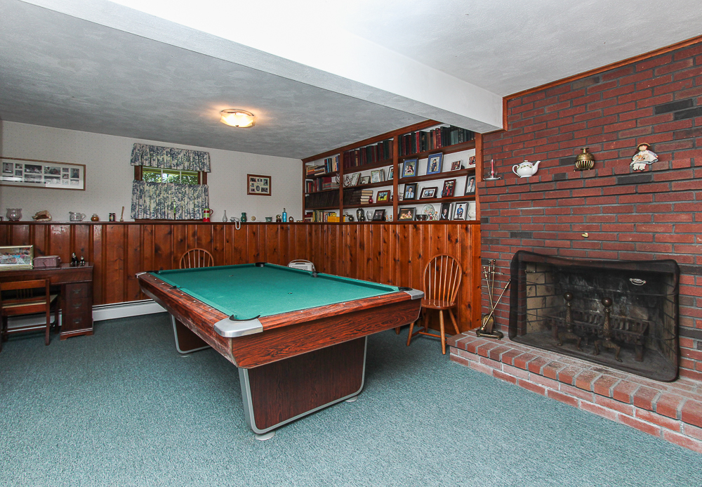 Lower level family room with fireplace and carpet 122 Hull Street Beverly Massachusetts