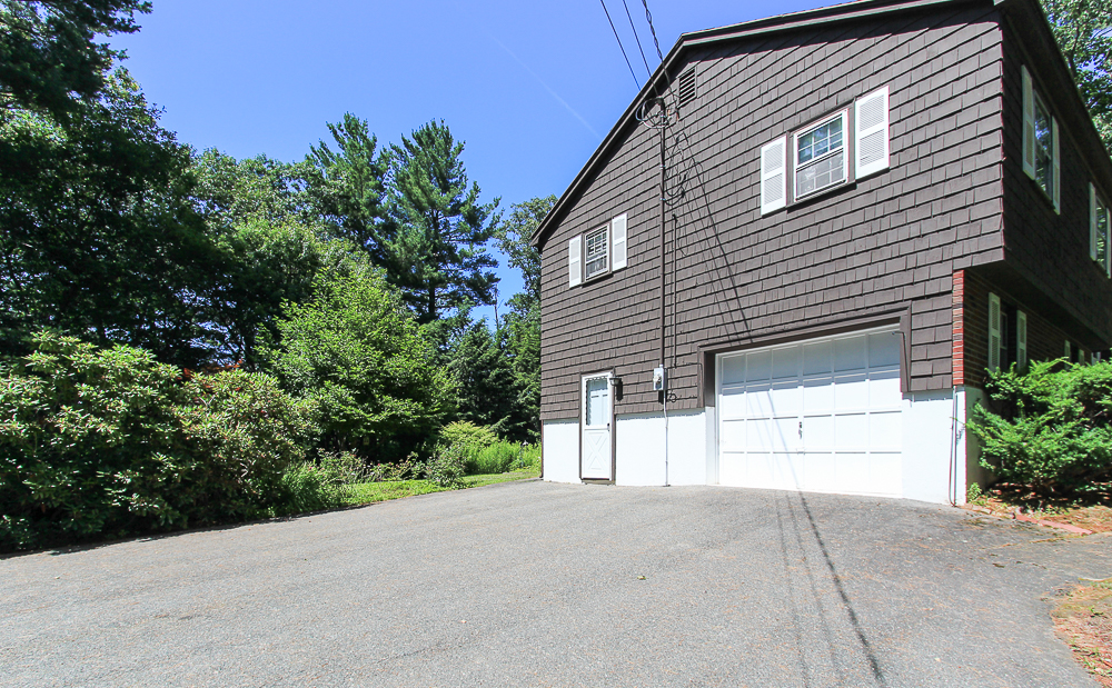 Driveway and garage with entry door 122 Hull Street Beverly Massachusetts